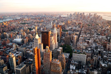 New York City Manhattan sunset skyline aerial view with office building skyscrapers and Hudson River. Stock Photo - 8201671