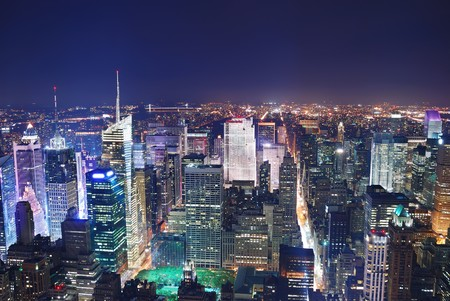 hudson: New York City Manhattan Times Square panorama aerial view at night with office building skyscrapers skyline illuminated by Hudson River. Stock Photo