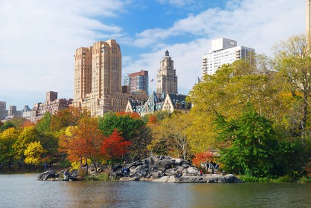 New York City Central Park in Autumn with Manhattan skyscrapers and colorful trees over lake with reflection. Stock Photo - 8201679