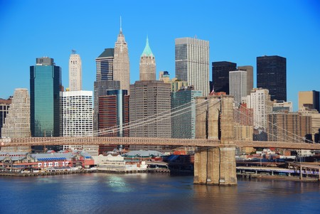 New York City Manhattan skyline with Brooklyn Bridge and skyscrapers over Hudson River in the morning after sunrise. Stock Photo - 8201615