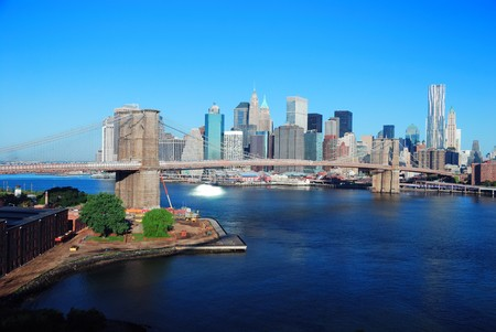hudson river: New York City Manhattan skyline with Brooklyn Bridge and skyscrapers over Hudson River in the morning after sunrise.