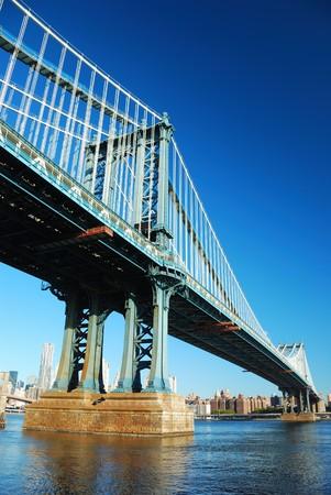 New York City Manhattan Bridge with skyscraper skyline in the morning over east Hudson River.
