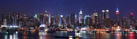 new york city times square: New York City Manhattan skyline panorama at night over Hudson River with refelctions viewed from New Jersey Stock Photo