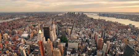 New York City Manhattan sunset skyline panorama aerial view with office building skyscrapers and Hudson River. photo