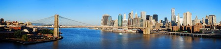 New York City Manhattan skyline panorama with Brooklyn Bridge and skyscrapers over Hudson River in the morning after sunrise. Imagens