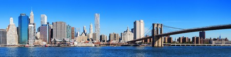 New York City Manhattan skyline panorama with Brooklyn Bridge and skyscrapers over Hudson River in the morning after sunrise. photo