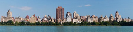 New York City Central Park panorama in Manhattan over lake with skyscrapers and fountain with trees and reflection. photo