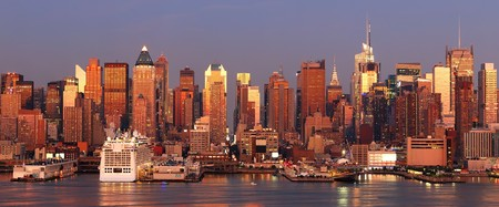 New York City Manhattan skyline panorama at sunset with Times Square and skyscrapers with reflection over Hudson river. photo