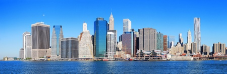 New York City Manhattan skyline panorama in the morning with skyscrapers over Hudson River with blue sky. Stock Photo