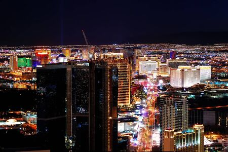 stratosphere: Las Vegas City Skyline panorama with sunset, mountain, luxury hotels and streets.