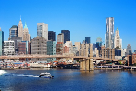 New York City Manhattan skyline with Brooklyn Bridge and skyscrapers over Hudson River in the morning after sunrise. Stock Photo - 8398002