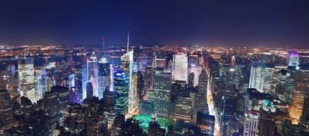 New York City Manhattan Times Square panorama aerial view at night with office building skyscrapers skyline illuminated by Hudson River. Stock Photo - 8398005