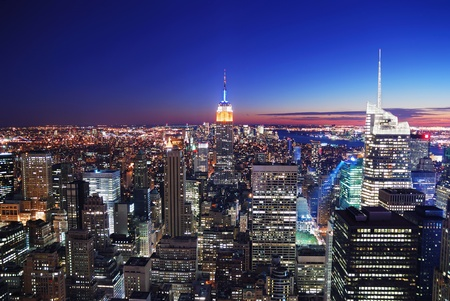 New York City Manhattan skyline aerial view with Empire State Building and Times Square at sunset. photo
