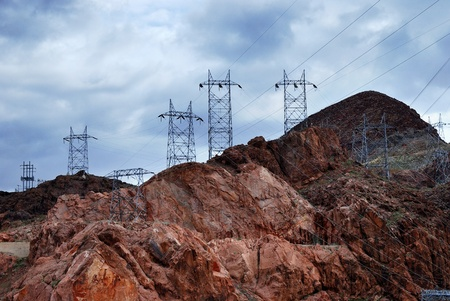 Power transmission tower silhouette over mountain from Hoover Dam at the boarder of Arizona and Nevada.  photo