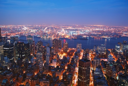 east river: New York City Manhattan skyline aerial view panorama with Brooklyn and Hudson east river at sunset.