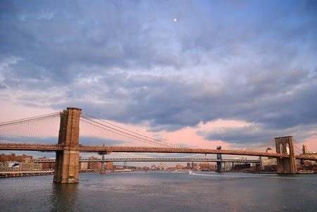 New York City Brooklyn Bridge with Manhattan skyline panorama at sunset photo