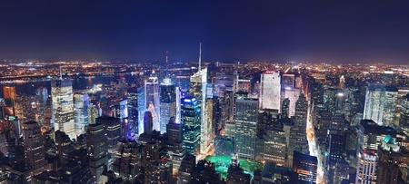 New York City Manhattan Times Square panorama aerial view at night with office building skyscrapers skyline illuminated by Hudson River. photo