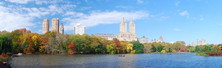 autumn in the city: New York City Manhattan Central Park panorama in Autumn lake with skyscrapers and colorful trees over with reflection.