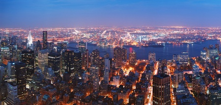 New York City Manhattan skyline aerial view panorama with Brooklyn and Hudson east river at sunset.  photo