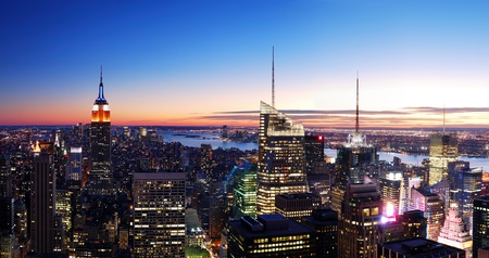 New York City Manhattan skyline panorama aerial view with Empire State Building and Times Square at sunset. photo