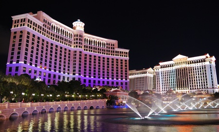 LAS VEGAS - MAR 4:  Las Vegas Bellagio Hotel Casino, featured with its world famous fountain show, at night with fountains on March 4, 2010 in Las Vegas, Nevada.