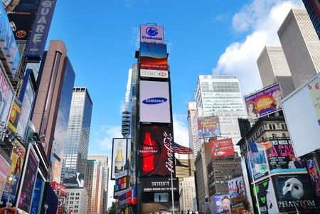 featured: NEW YORK CITY - SEP 5: Times Square, featured with Broadway Theaters and LED signs, is a symbol of New York City and the United States, September 5, 2009 in Manhattan, New York City.