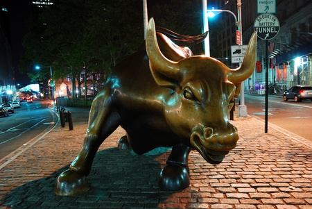 charging bull: NEW YORK CITY - AUG 7: Wall Street Charging Bull, the symbol of aggressive financial optimism and prosperity and the famous landmark of Wall Street, closeup at night on August 7, 2010 in Manhattan, New York City.  Editorial