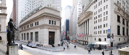 stock: NEW YORK CITY - JAN 1: Wall Street panorama with New York Stock Exchange and George Washington Statue in Manhattan Finance district during United States economy recovery, January 1, 2010 in Manhattan, New York City.