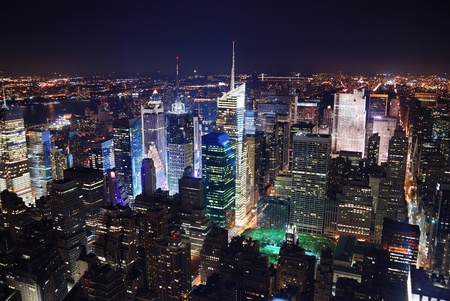 New York City Manhattan Times Square panorama aerial view at night with office building skyscrapers skyline illuminated by Hudson River. Stock Photo - 8499676