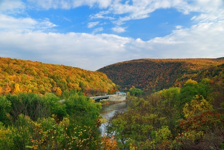 Delaware Water Gap panorama in Autumn with colorful foliage with forest and mountain over river.  photo