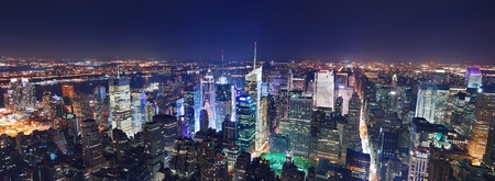 hudson river: New York City Manhattan Times Square panorama aerial view at night with office building skyscrapers skyline illuminated by Hudson River. Stock Photo