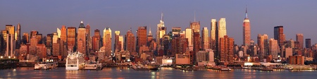 new york: New York City Manhattan skyline panorama at sunset with empire state building, Times Square and skyscrapers with reflection over Hudson river.