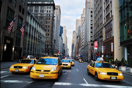 a yellow taxi: NEW YORK CITY - AUG 8: The taxicabs of New York City, with their distinctive yellow paint, are a widely recognized icon of the city. August 8, 2010 in Manhattan, New York City.