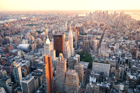 new york: New York City Manhattan sunset skyline aerial view with office building skyscrapers and Hudson River. Stock Photo