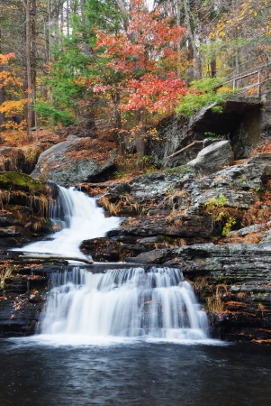 background waterfalls: Waterfall with trees and rocks in mountain in Autumn. From Pennsylvania Dingmans Falls.