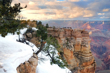 rock canyon: Grand Canyon panorama view in winter with snow and clear blue sky.