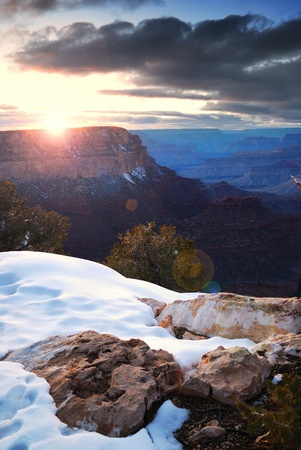 Grand Canyon sunrise in winter with snow and cloudy blue sky. Stock Photo - 8550904