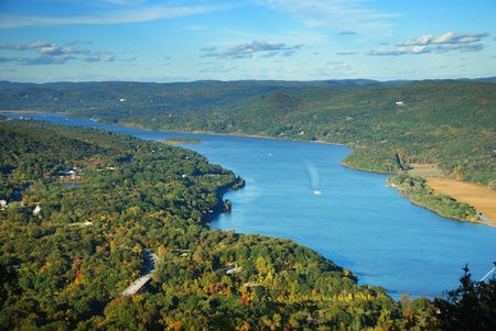 scenic: Autumn Mountain peak view panorama with colorful foliage in forest and Hudson River.