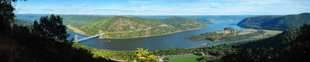 river: Hudson River valley panorama in Autumn with colorful mountain and Bear Mountain Bridge over Hudson River.