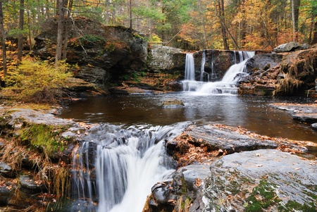 Waterfall with trees and rocks in mountain in Autumn. From Pennsylvania Dingmans Falls. photo