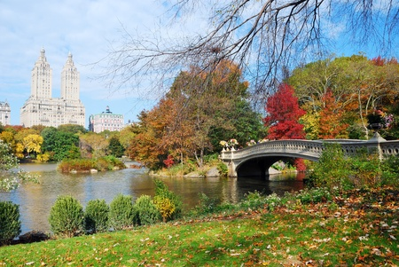 New York City Manhattan Central Park panorama in Autumn lake with bridge skyscrapers and colorful trees with reflection. photo