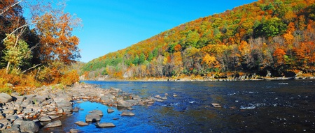 Autumn Mountain with river panorama view and colorful foliage in forest.