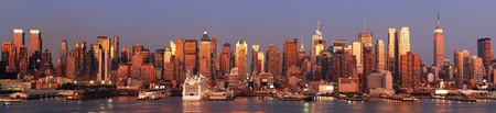 New York City Manhattan skyline panorama at sunset with empire state building, Times Square and skyscrapers with reflection over Hudson river. Stock Photo - 8586545