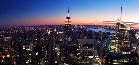 empire state: New York City Manhattan skyline panorama aerial view with Empire State Building and Times Square at sunset.
