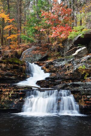 stream: Waterfall with trees and rocks in mountain in Autumn. From Pennsylvania Dingmans Falls.