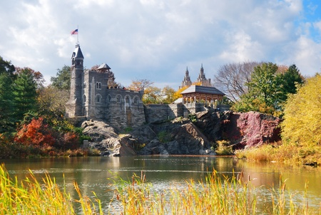 autumn in the city: New York City Manhattan Central Park in Autumn with Belvedere Castle and colorful trees over lake with reflection.