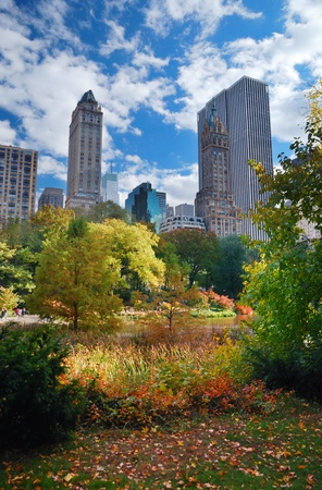 New York City Manhattan Central Park panorama in Autumn with colorful trees and skyscrapers.
