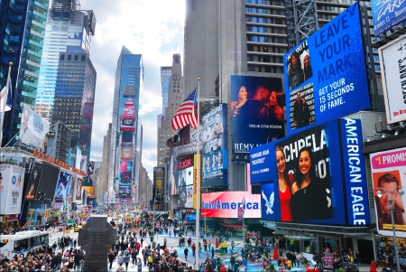 popular: NEW YORK CITY - SEP 5: Times Square, featured with Broadway Theaters and LED signs, is a symbol of New York City and the United States, September 5, 2010 in Manhattan, New York City.