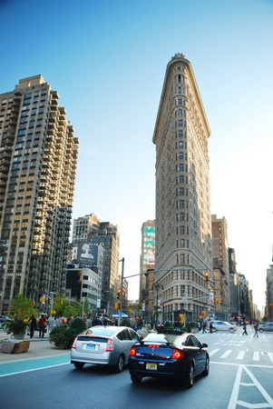NEW YORK CITY - DEC 7: Flat Iron building, considered to be one of the first skyscrapers ever built, with New York City street view. December 7, 2009 in Manhattan, New York City.  Stock Photo - 8790685