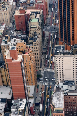 New York City Manhattan street aerial view with skyscrapers, pedestrian and busy traffic. photo